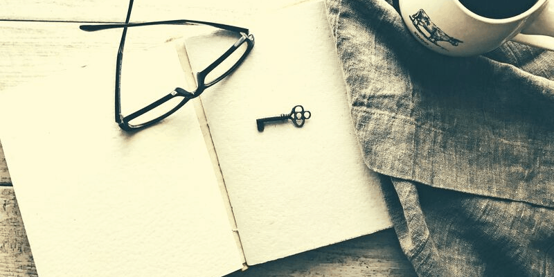 Journal and glasses on a table