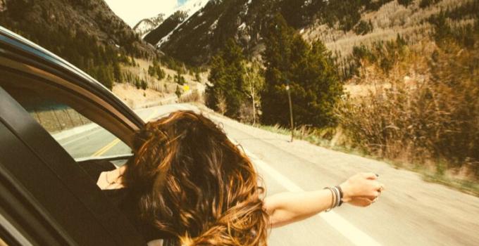 happy woman enjoying car drive