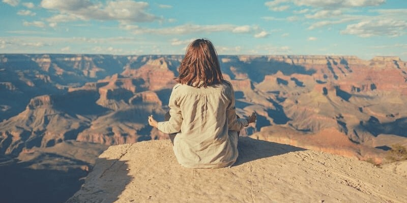 woman meditating as a self-nourishing; self-care ideas
