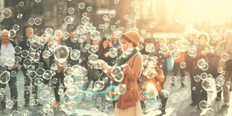 happy woman smiling among soap bubbles