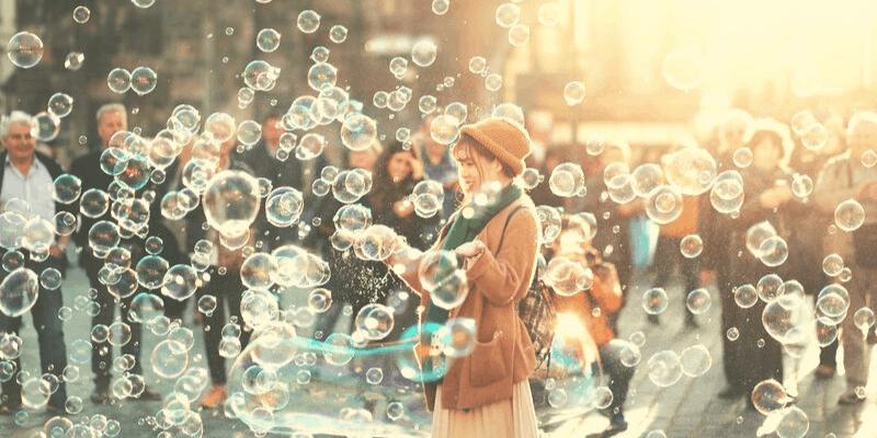 happy woman smiling among soap bubbles