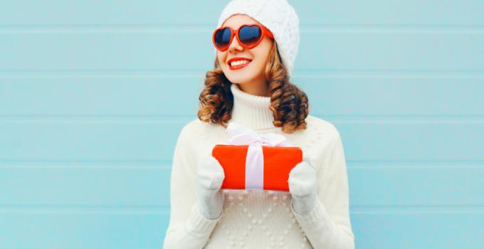 woman-heart-glasses-holding-christmas-gift