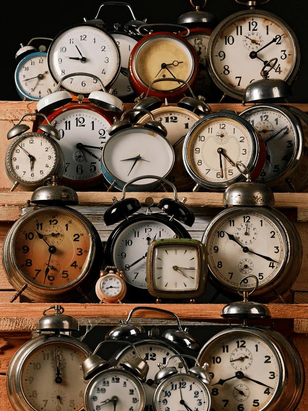 a-lot-of-clocks-on-shelves