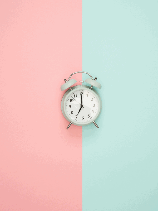 clock-with-blue-and-pink-background