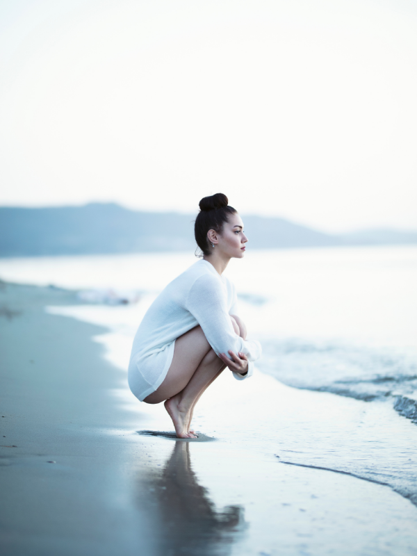 woman-thinking-on-the-beach
